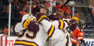 UMD players celebrate a late third period goal (2019 Omar Phillips)